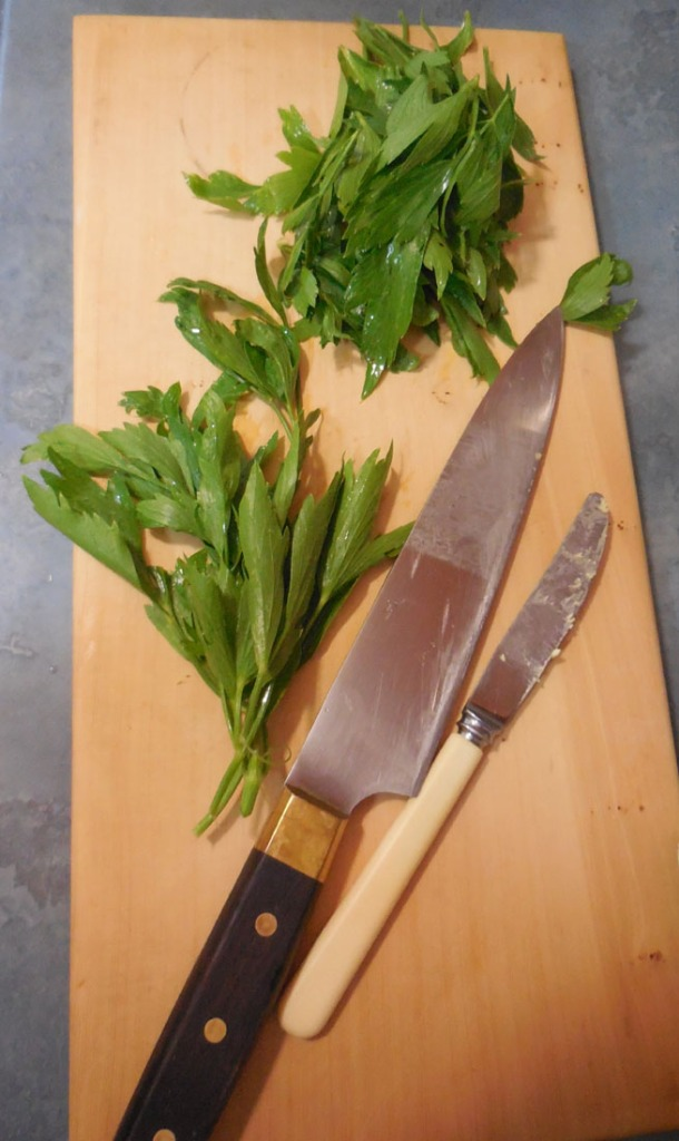 Lovage leaves on the chopping board